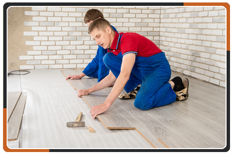 Young Man Laid Laminate Floor Covering