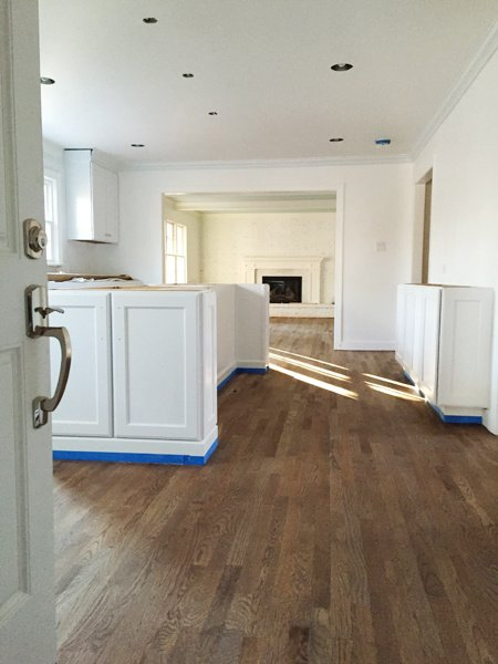 https://0201.nccdn.net/4_2/000/000/038/2d3/Refinishing-Hardwood-Floors-First-Coat-With-Cabinets-450x600.jpg