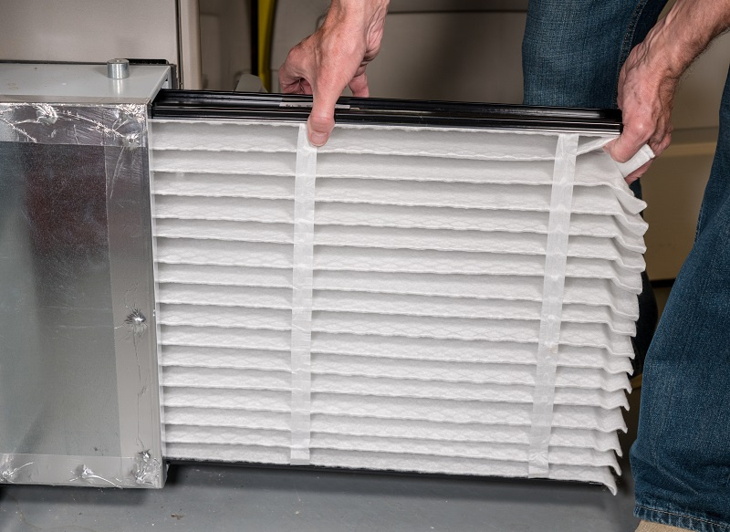 Changing HVAC furnace filter