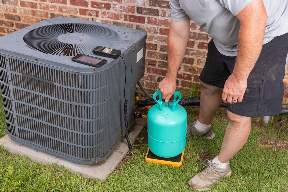 Tech with Refrigerant Outside AC Unit