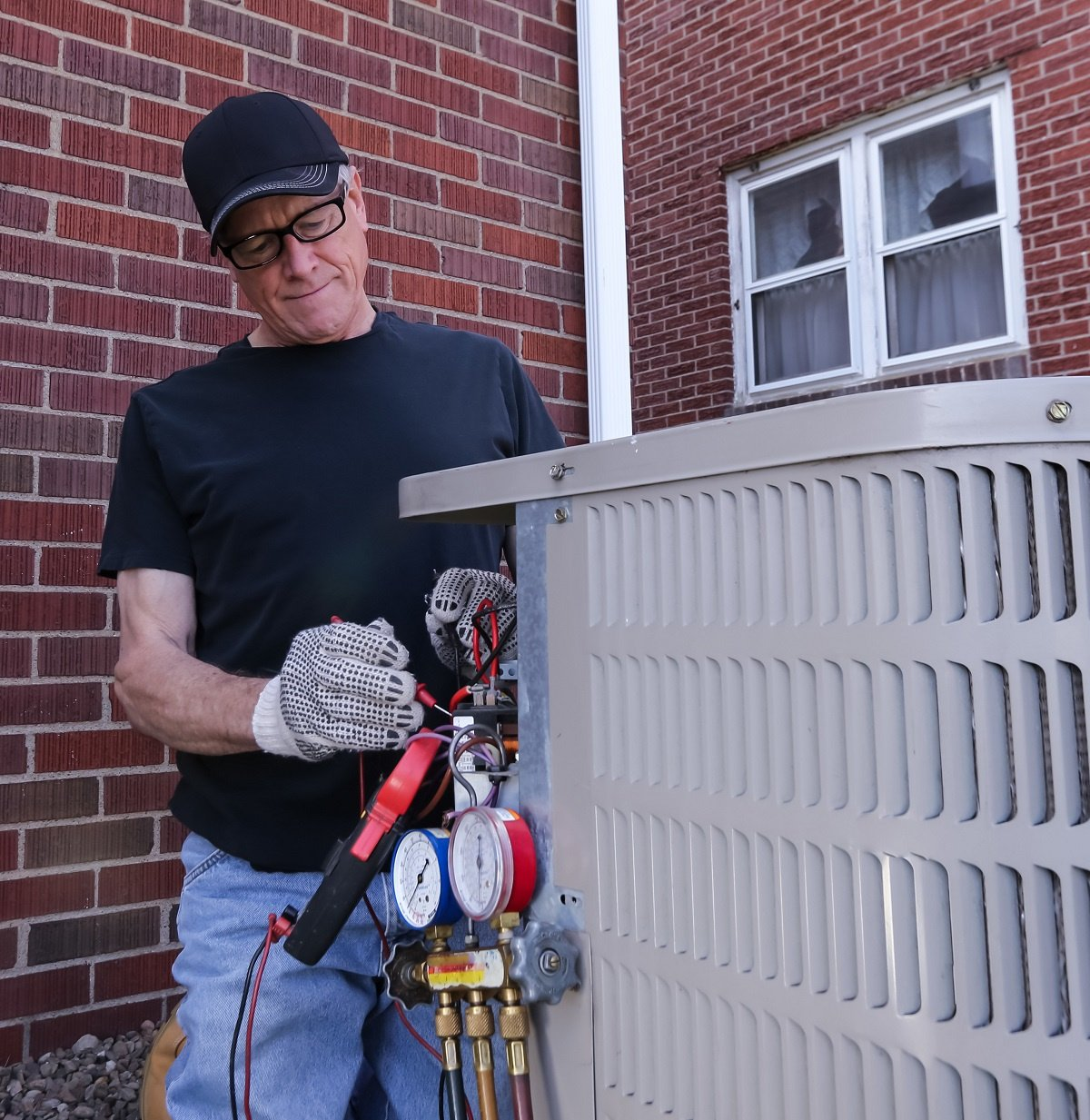 Man providing residential HVAC Service in Kennesaw