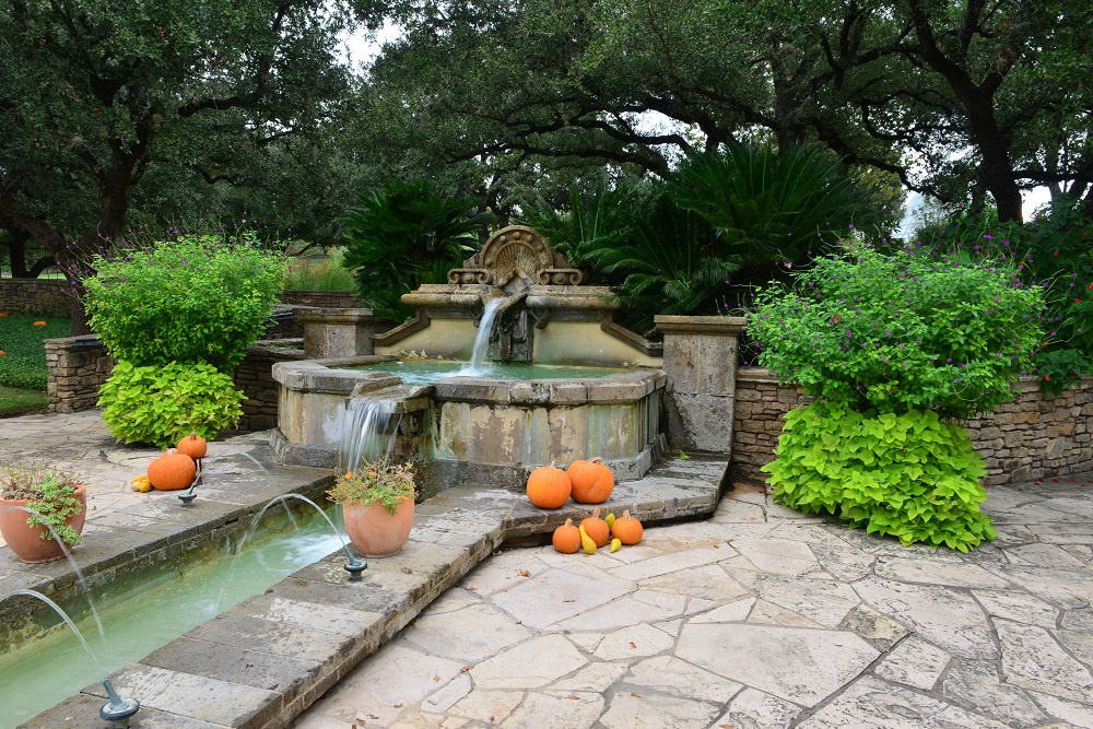 Large elegant water fountain with fall décor