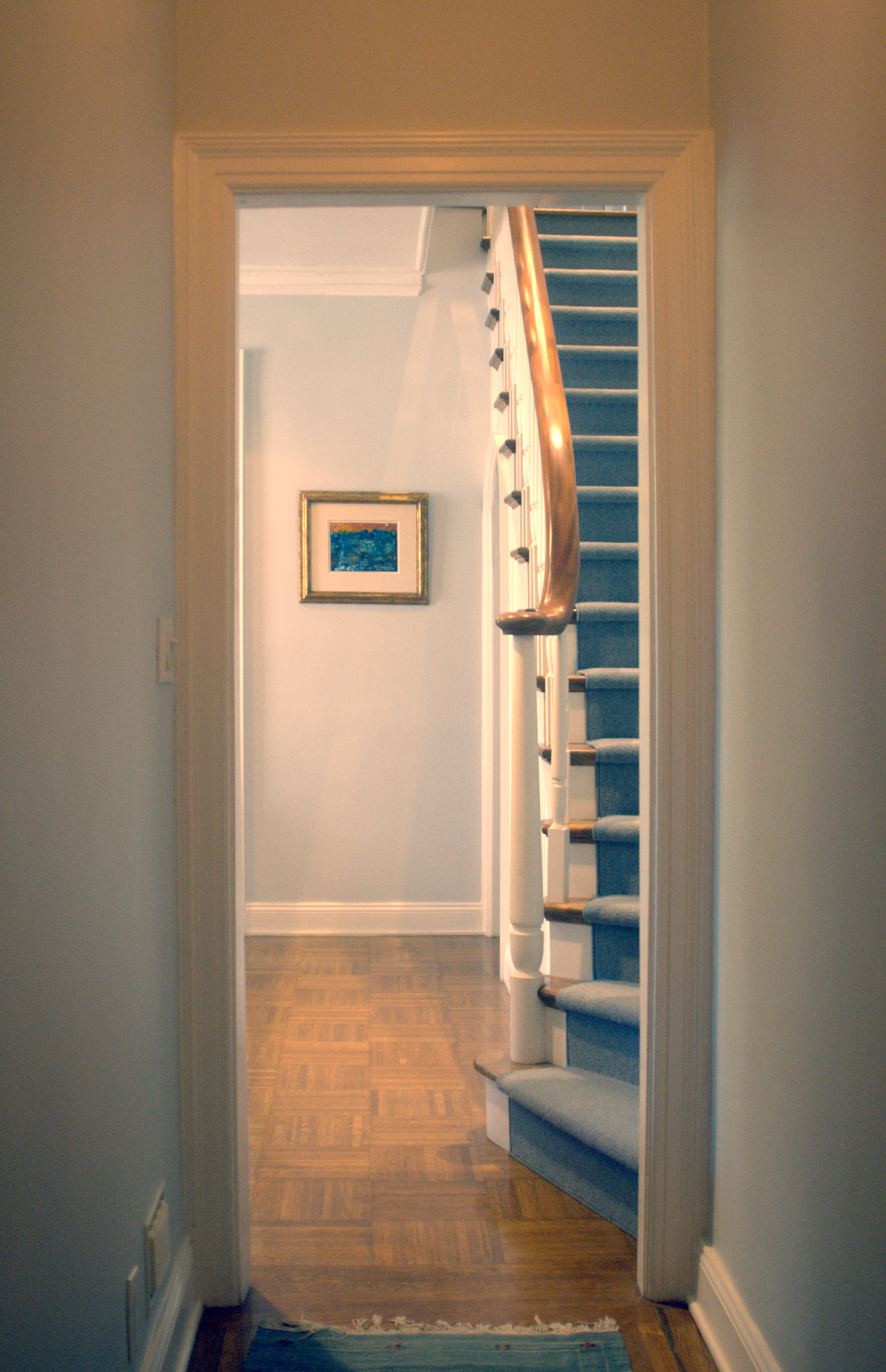 The new stair seen here from the entry vestibule so that the combined apartment feels like a townhouse in the sky.