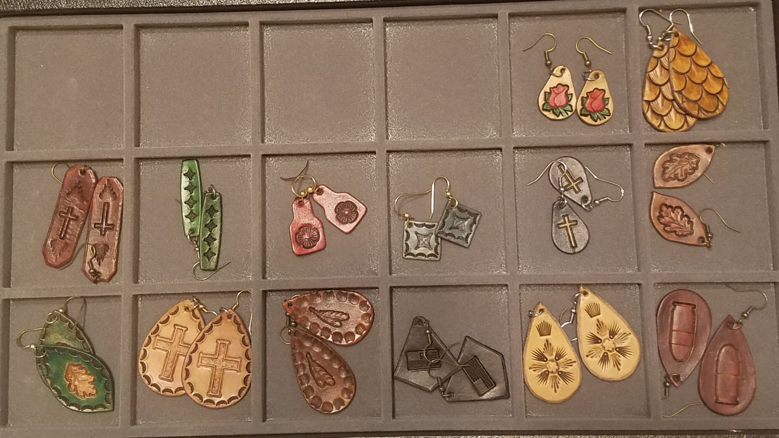 Various leather ear rings,  $15.00 ea