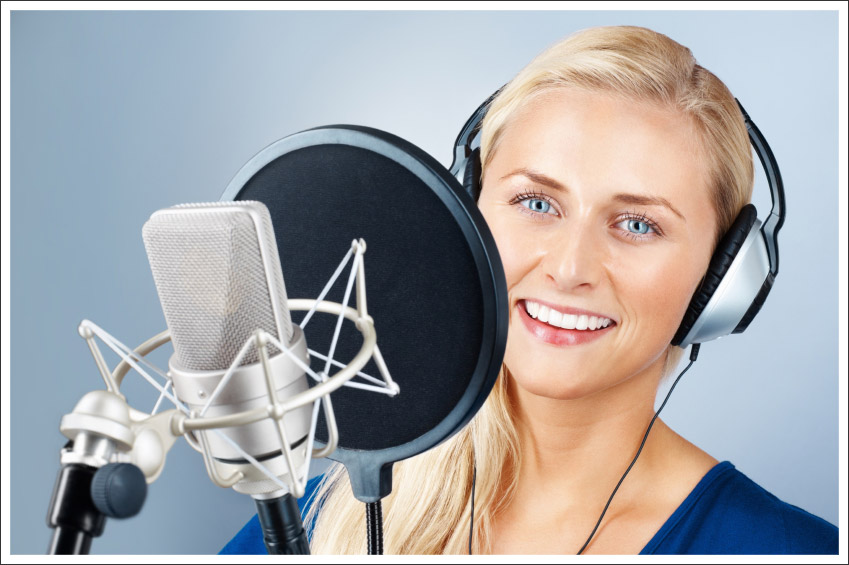 Smiling woman with microphone||||