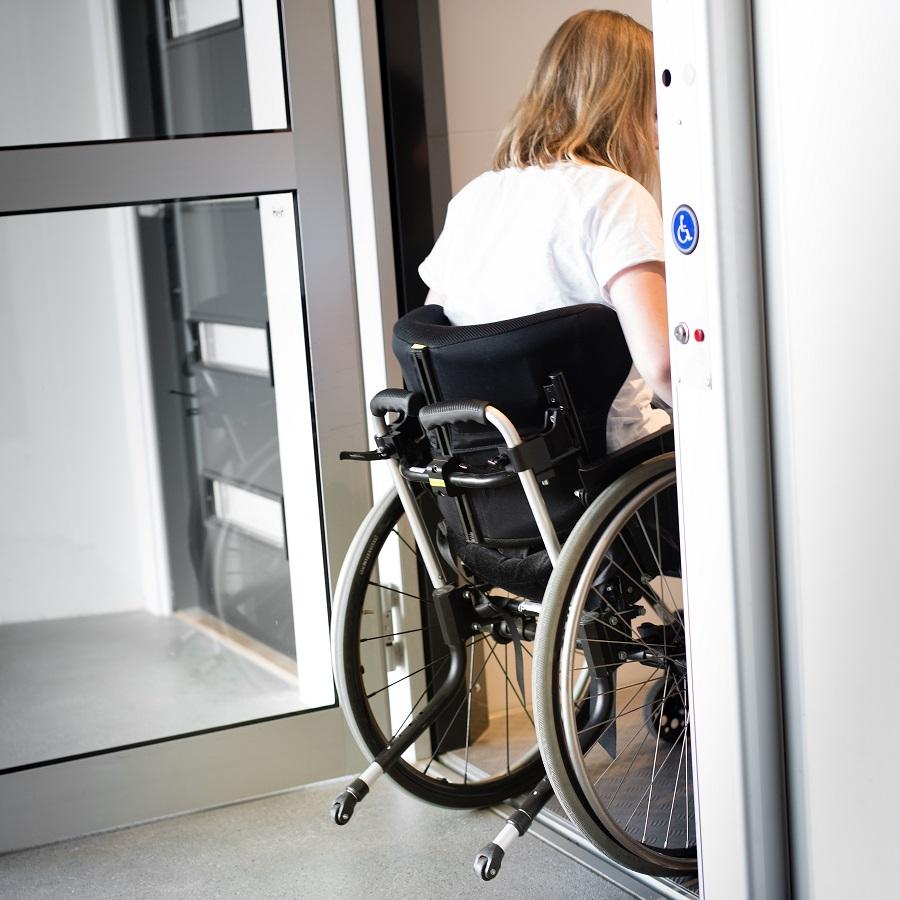 Person in Wheelchair Entering Elevator