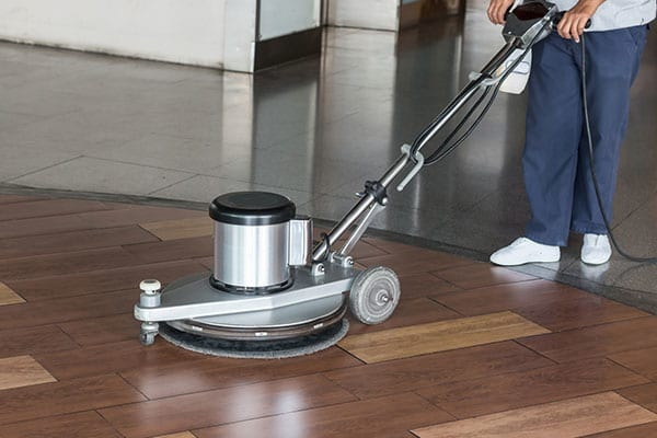 Cleaning the Floor with Polishing Machine