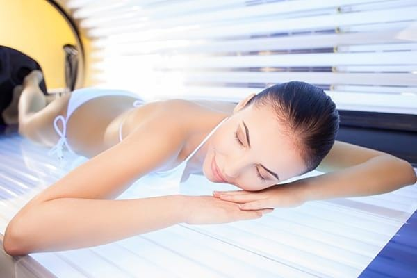 Woman is Getting Tanning Treatment