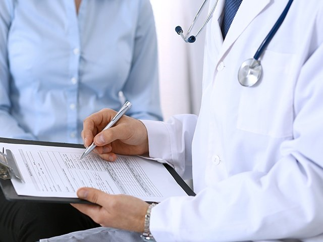 Male Doctor Holding Application Form