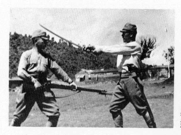 At Camp Jinmu on the North China-Soviet border 1944. Conducting a special performance of sword versus bayonet forms during a military festival.  Bayonet, Sergeant Major Yoshii; Sword, Sergeant Nakamura Taizaburo. (Photo courtesy Nakamura Taizaburo)