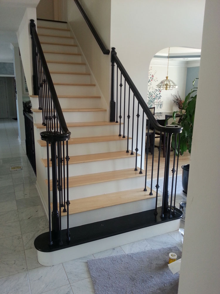 Stairs With Cream Hardwood Flooring
