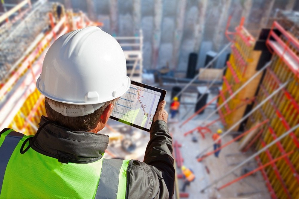 Construction worker using tablet on worksite