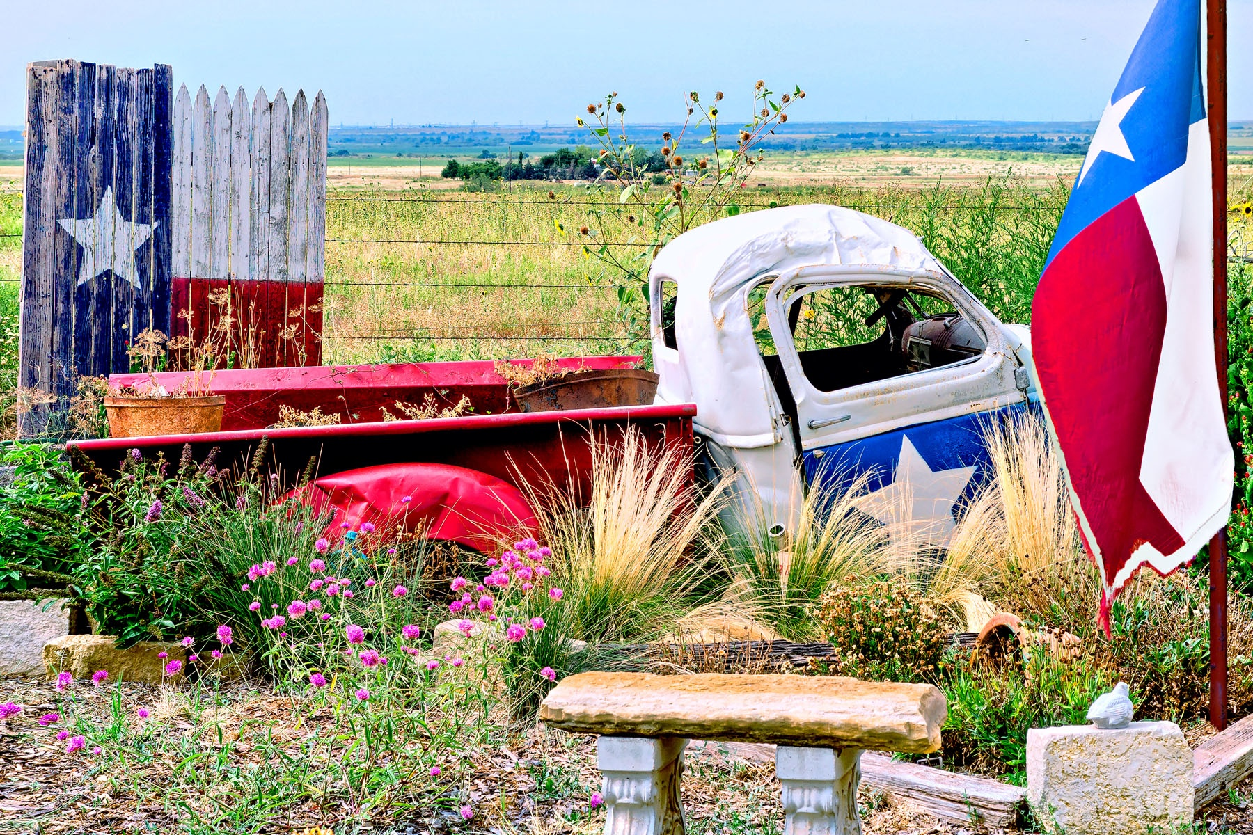 OLE' TEX - That was the name of this old truck used as a garden sculpture at the entrance to a ranch in Texas.