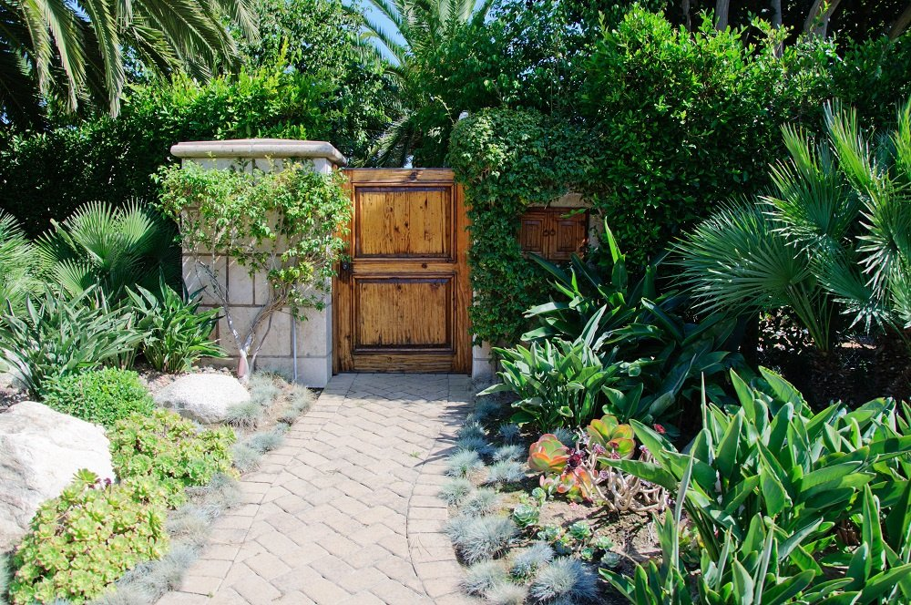 Beautiful wooden gate entrance to yard