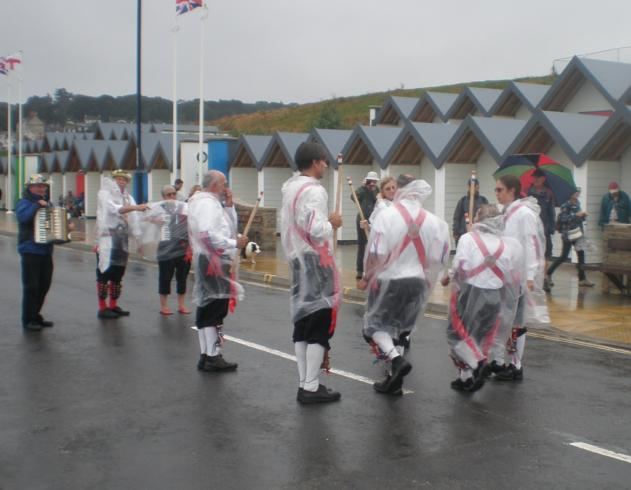 One of the other teams dancing in the rain