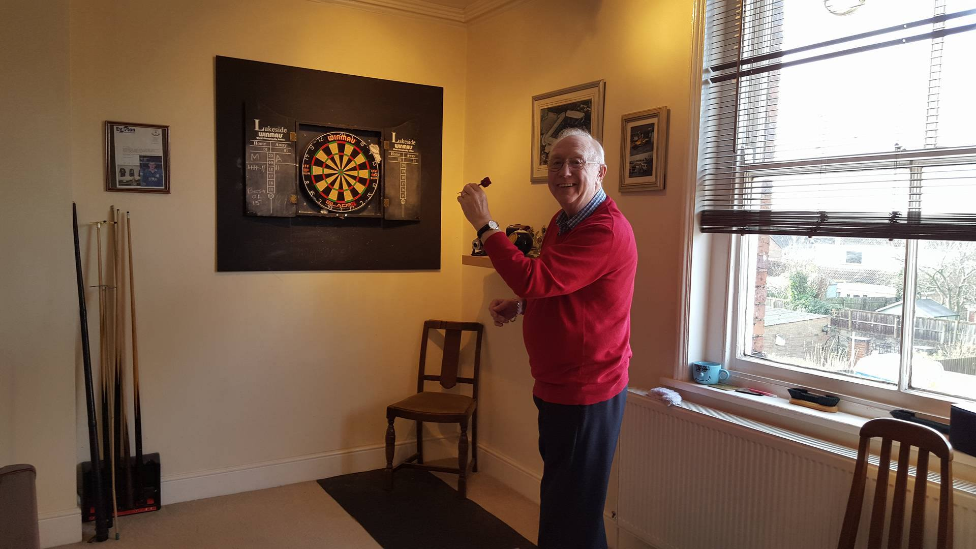 Derek enjoying a game of darts with Terry