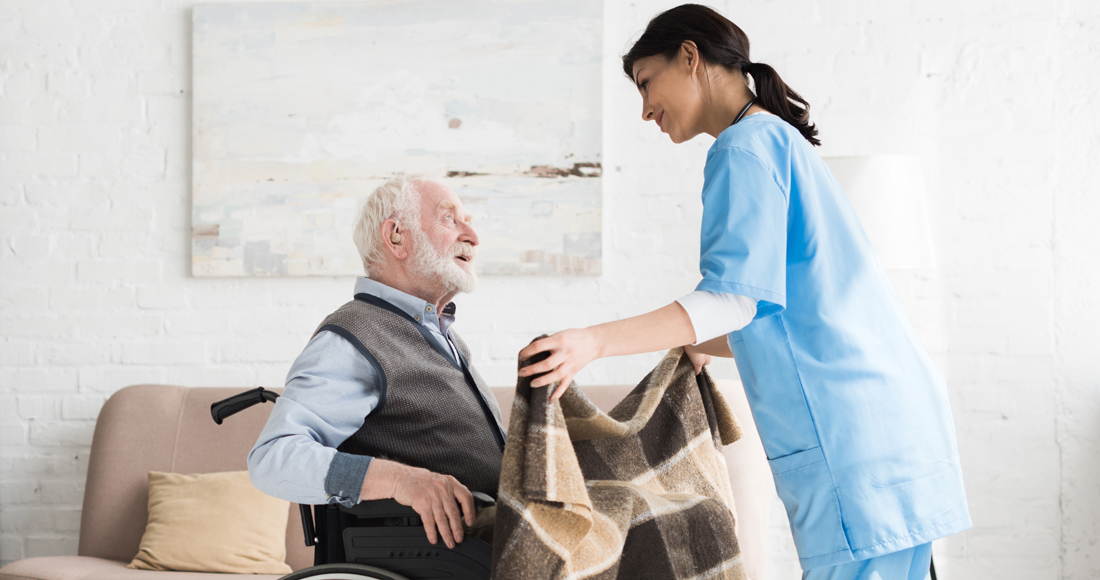 Caring Nurse Covering Blanket