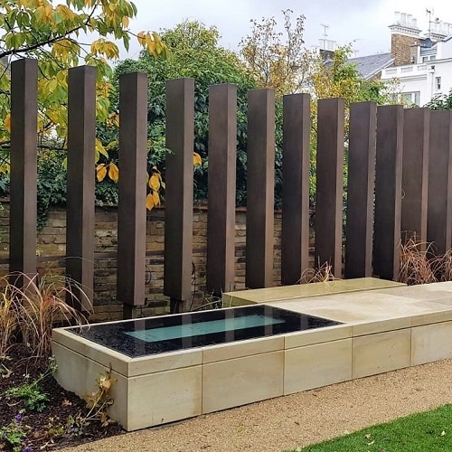 Metal coating in bronze. Private London garden designed by Andy Sturgeon Garden Design. Artistic Metals