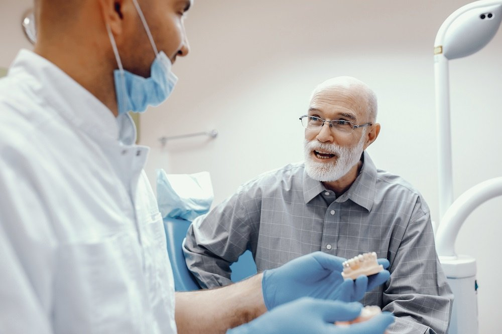 Older Man Talks to Dentist