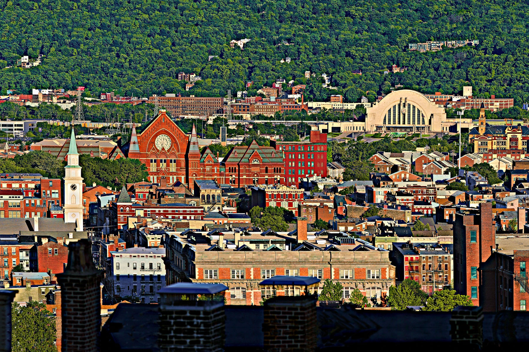 "OVER THE RHINE - This view of the ""over the rhine"" area in Cincinnati covers about two miles. That means there can be no haze if you want a clear shot. There aren't many haze-free summer days in Cincinnati. I tried often, but it took me almost two years to get this shot."
