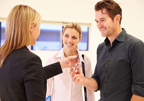 Estate Agent Handing Over Keys