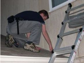 Person inspecting roof