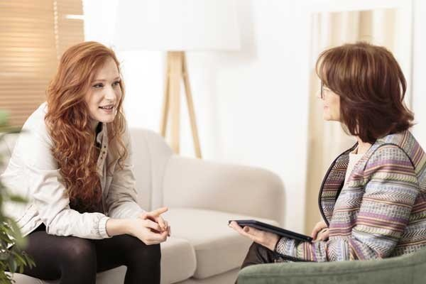 Friendly Therapist Supporting Woman