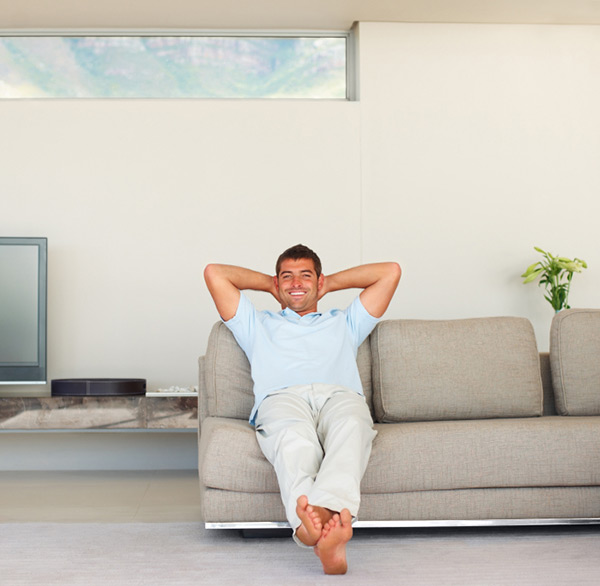Young guy relaxing on couch at home