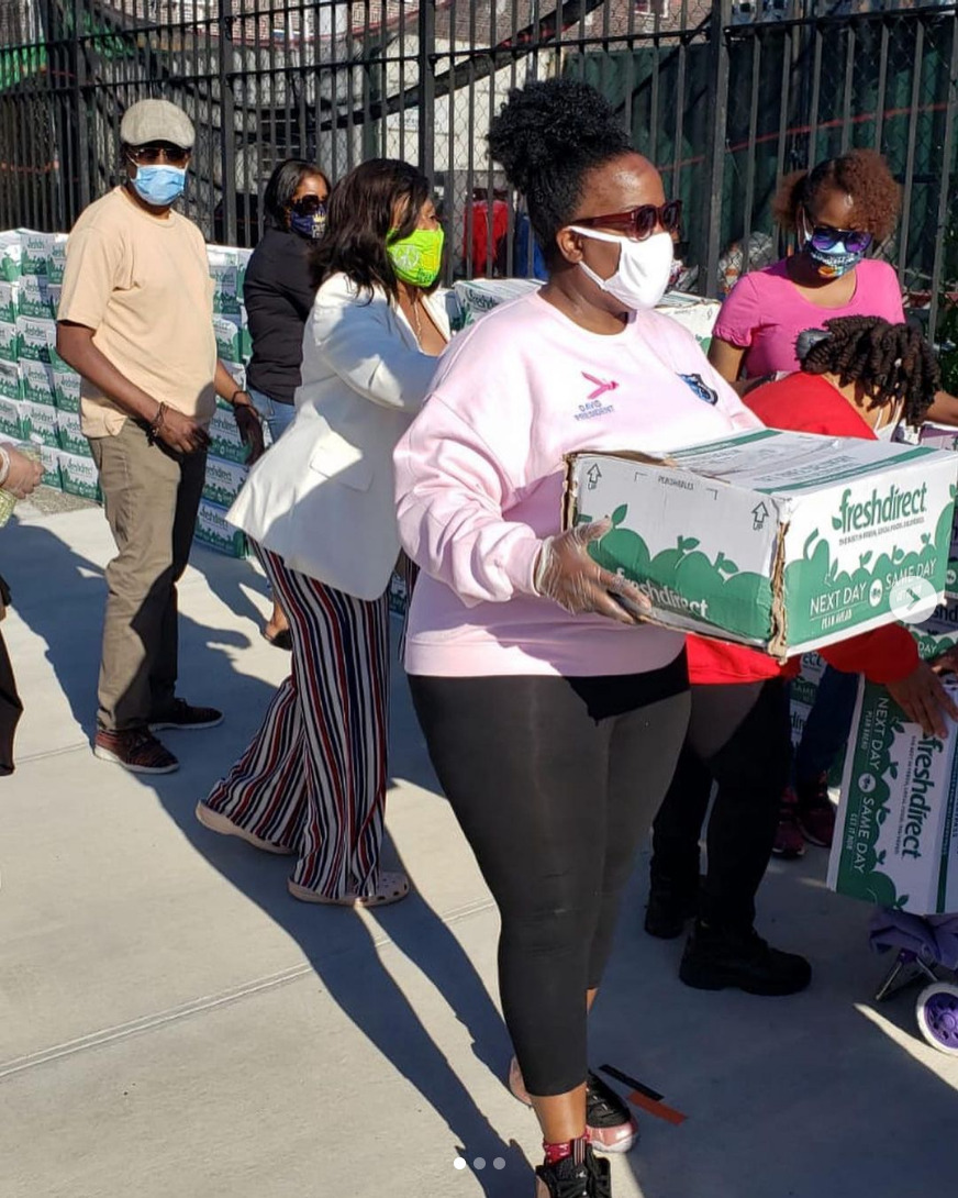 Donating boxes of fresh food to local residents