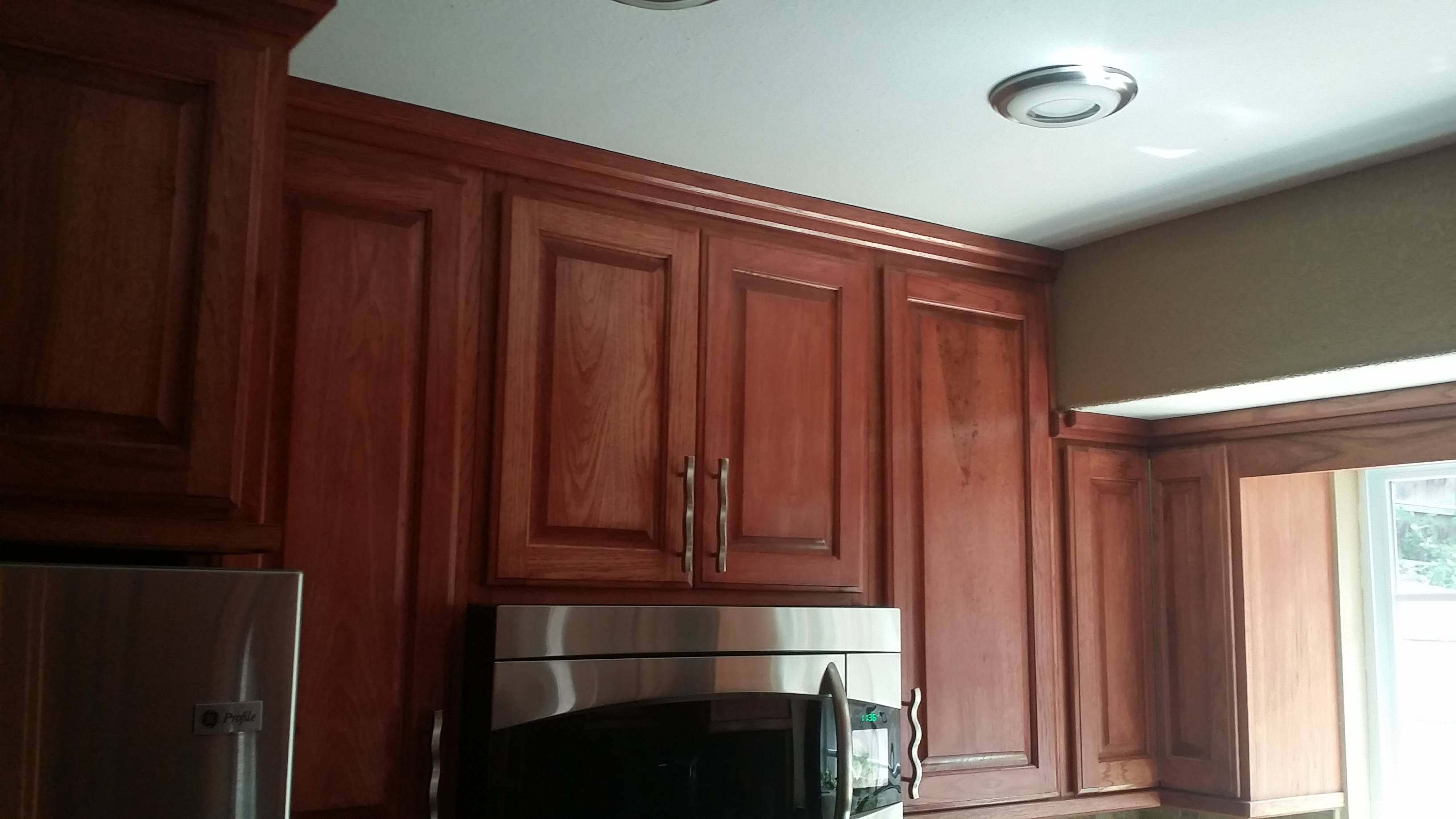 Wall Cabinets feature Sedona Red Hickory  Raised Panels, soft close door hinges and soft  close full slide out drawers.