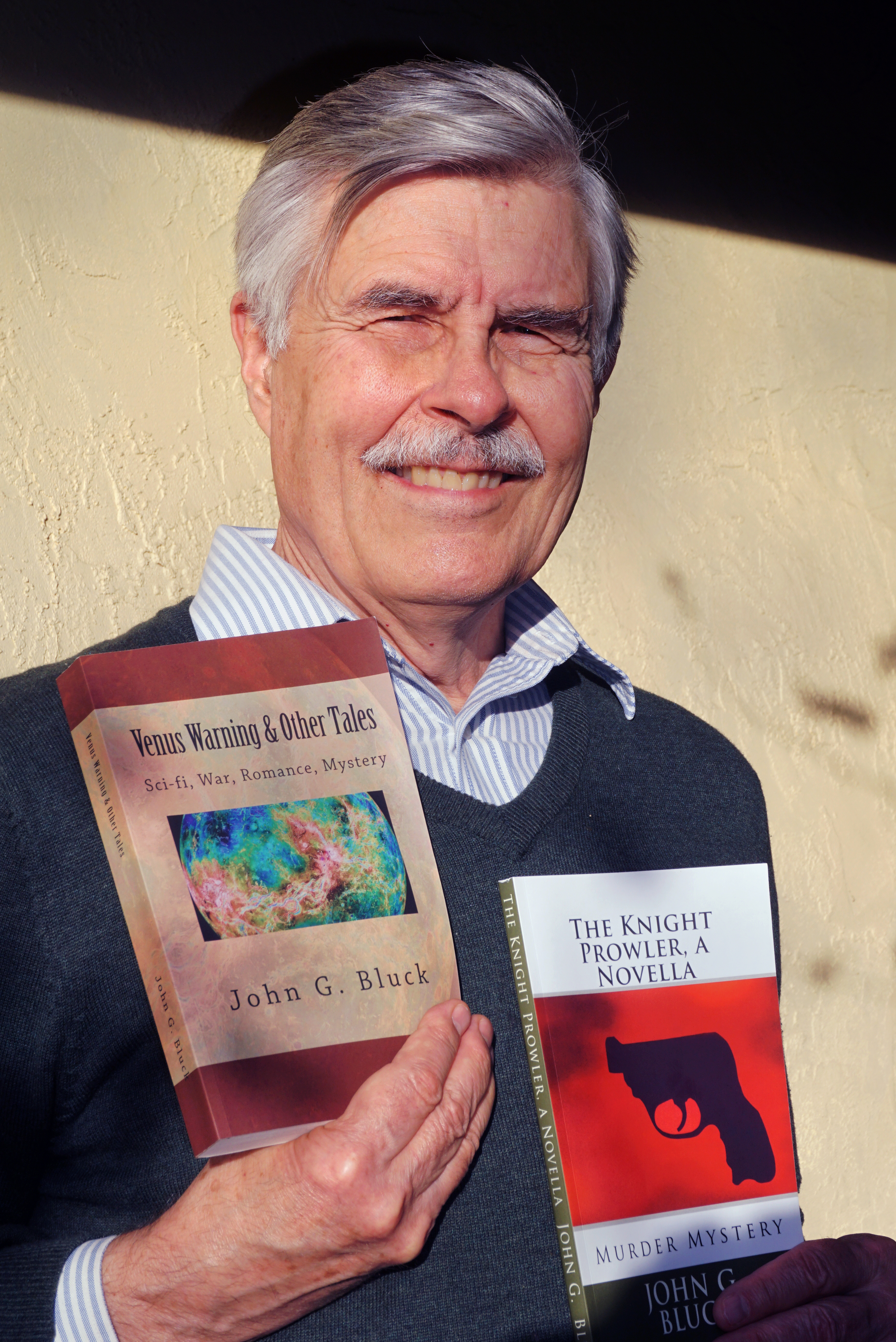 "Author John G. Bluck with his book of short stories, ""Venus Warning & Other Tales,"" and his first mystery, ""The Knight Prowler, a novella."""