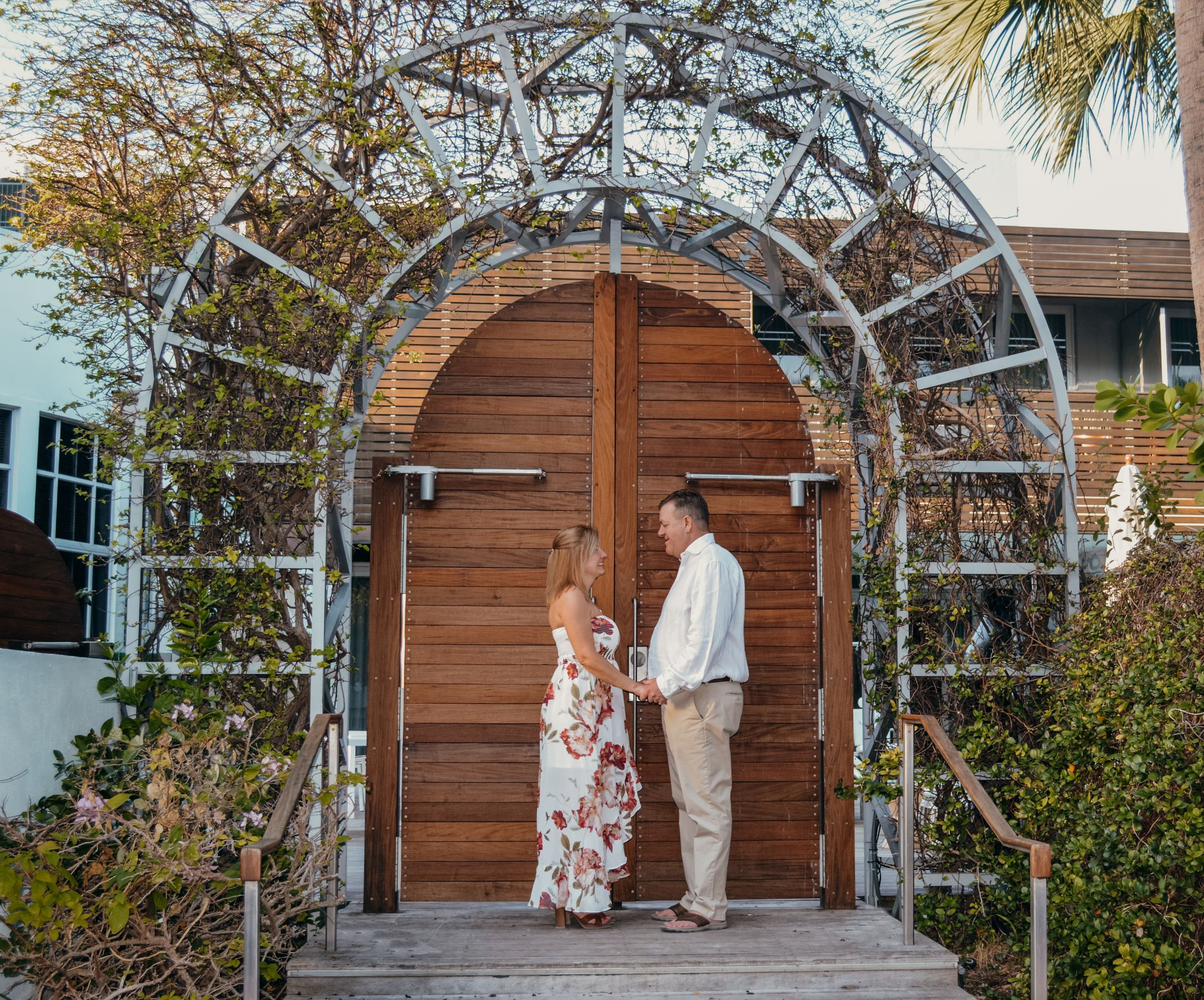 https://0201.nccdn.net/4_2/000/000/04b/787/bride-and-groom-fron-of-door.jpg