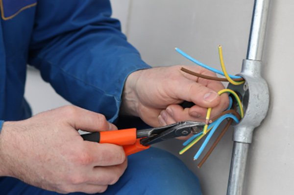Electrician preparing cables for connection