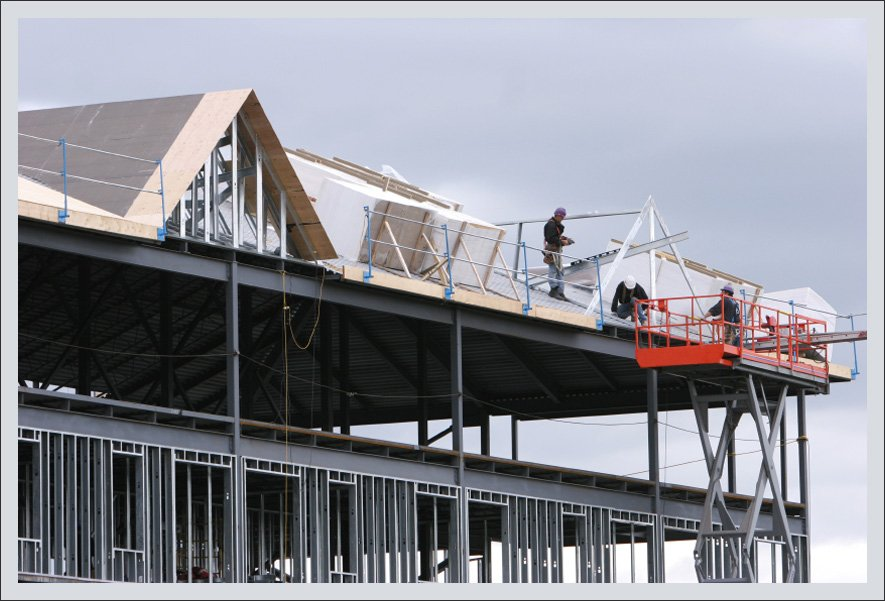 Men working on roof installation