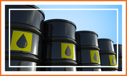 Crude Fuel Barrels With Yellow Label