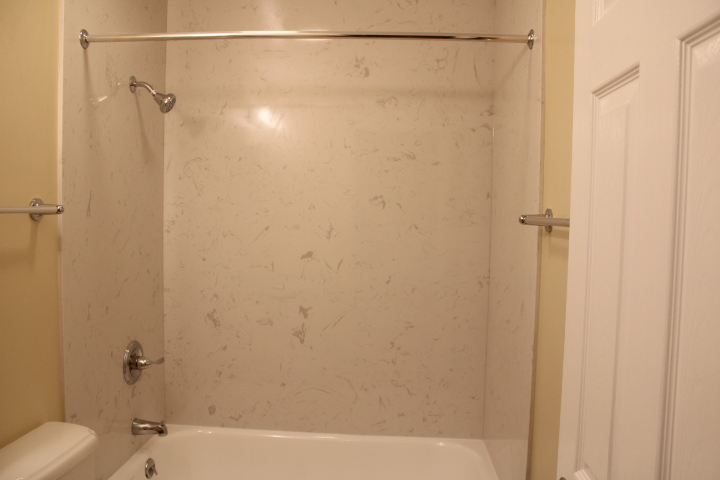 The shower is solid-surface, marble!