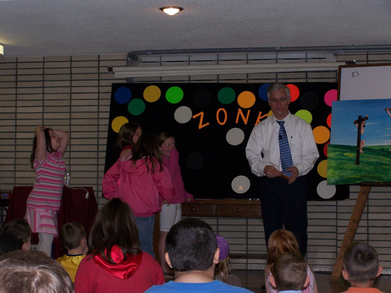 Brother Jim asks a question from the Bible Story.  A child can participate in the game if he/she answers the question correctly.