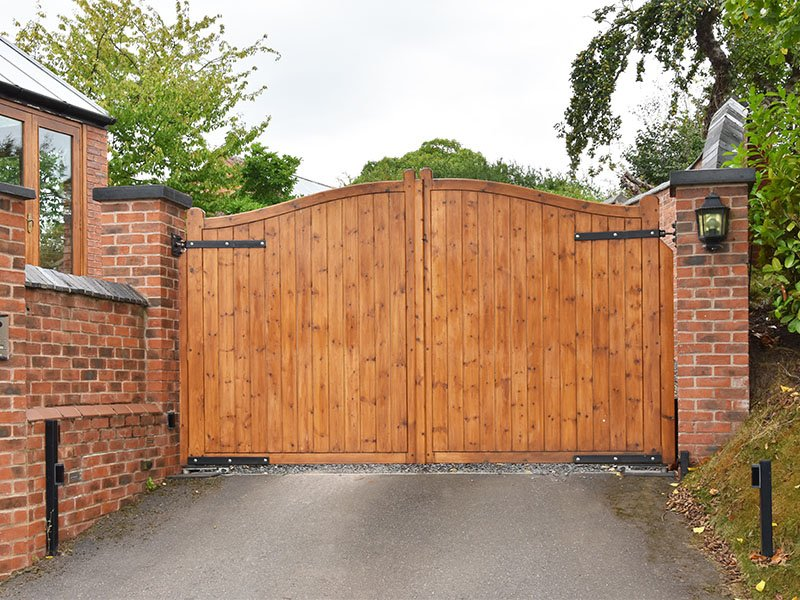 Wooden security gate with keypad operated lock