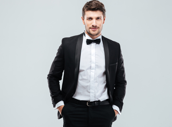 Confident Young Man in Tuxedo with Bowtie