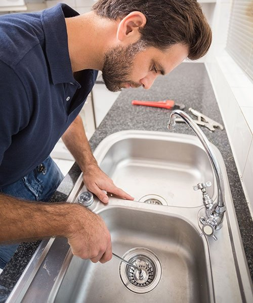 Plumber Fxing Sink With Screwdriver
