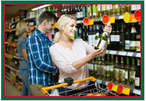 Couple of Customers Purchasing at Wine Section in Supermarket