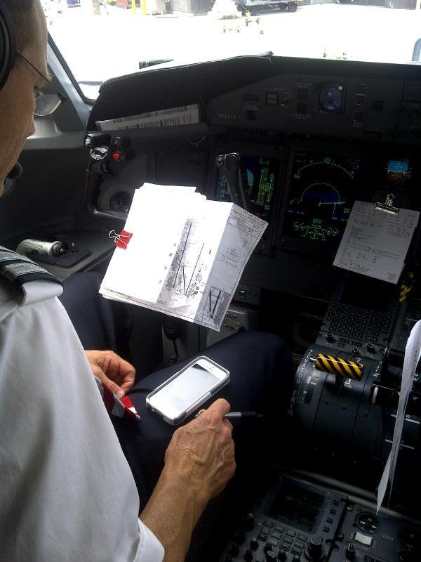 Pilot reading from smart phone||||