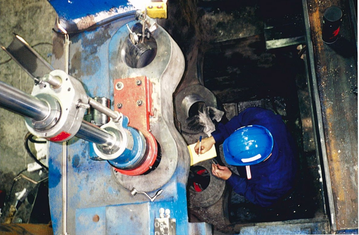 Skilled Mechanic Repairing Industrial Machine