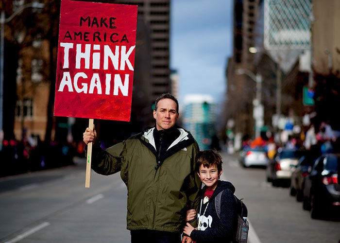 Man and Boy with Red Signage