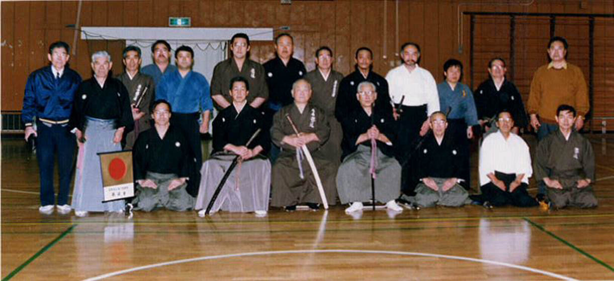 January 1995. Front row center: Nakamura Taizaburo sensei flanked by Sato Shimeo (Hanshi 9th dan) and Suzuki Kunio (Kyoshi, 8th dan) on the left. Back row, 4th from the right: Ron Zediker (Renshi, 6th dan).