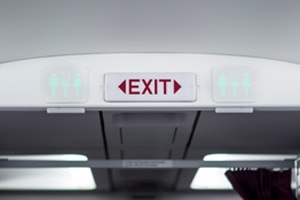 Exit and Toilet Sign on Plane