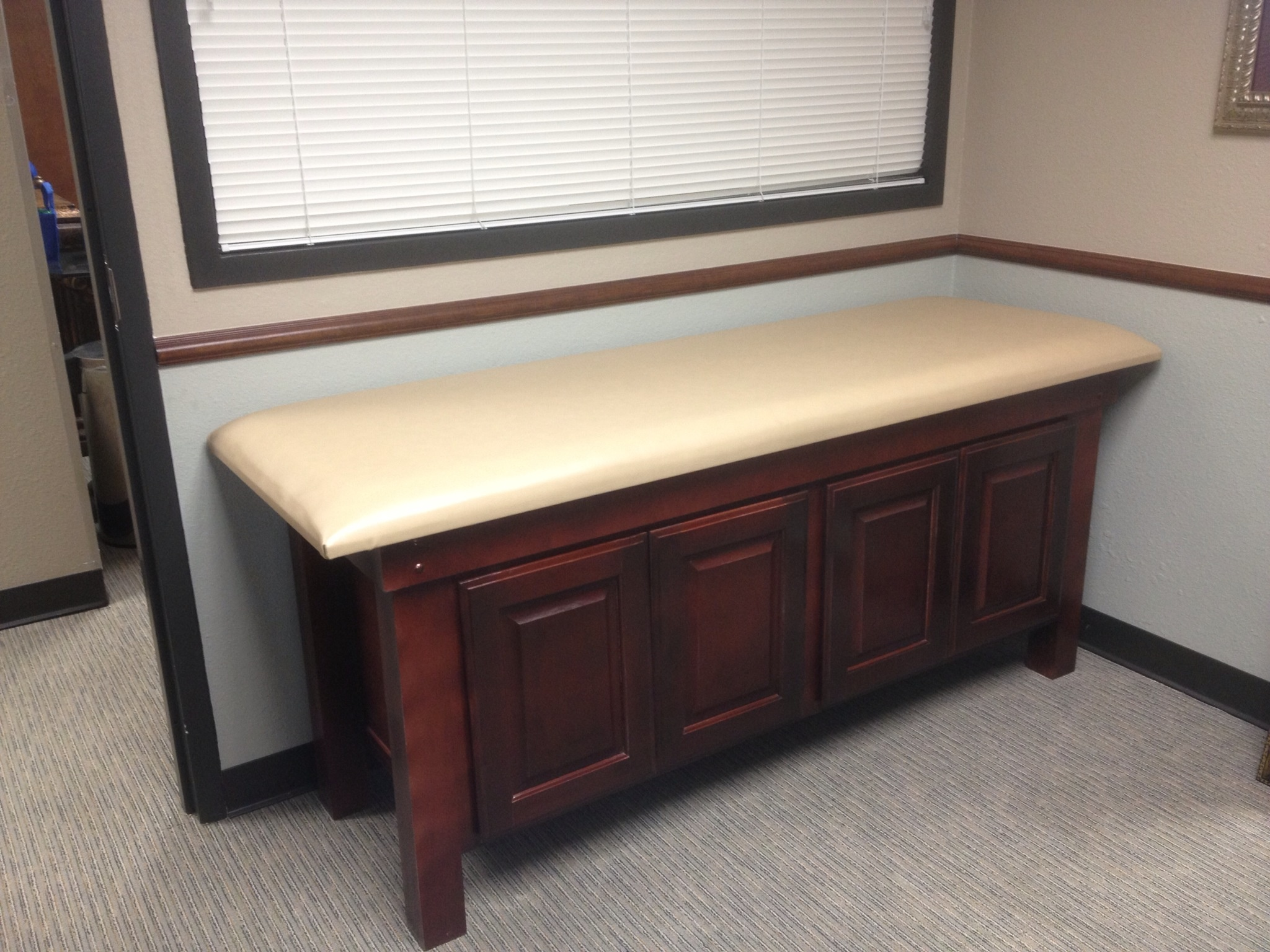 Exam table features 4 raised panel doors.