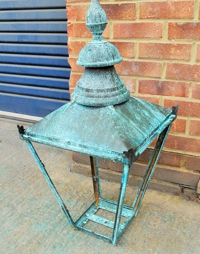Verdigris finish on a garden lamp. Artistic Metals