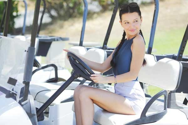 Woman In Golf Car