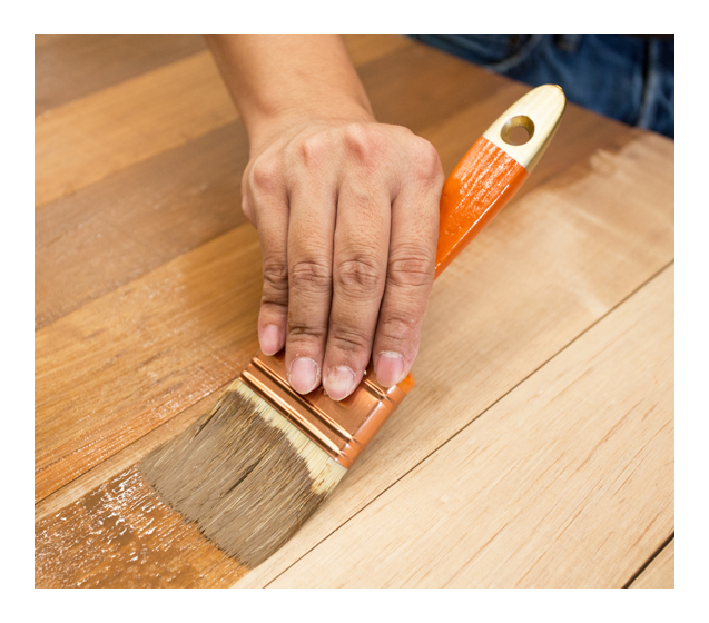 Applying Protective Varnish On A Wooden Furniture